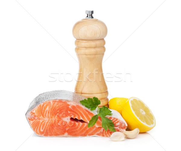 Salmon with herbs, pepper shaker and lemon Stock photo © karandaev