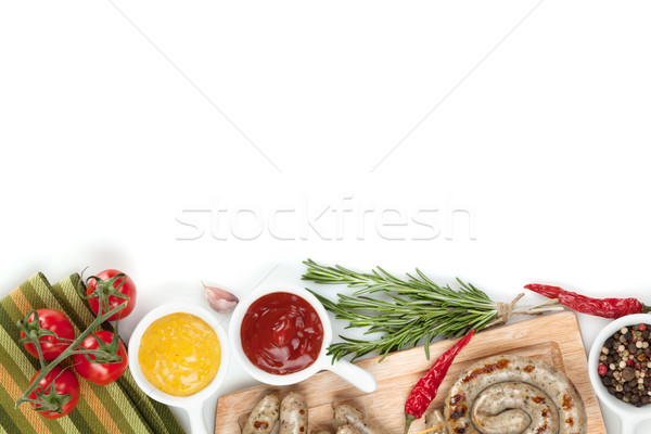 Grilled sausages with ketchup and mustard Stock photo © karandaev