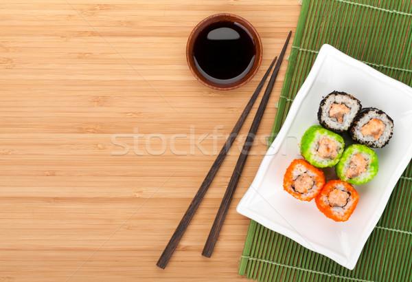 Colorful sushi maki with tobiko Stock photo © karandaev