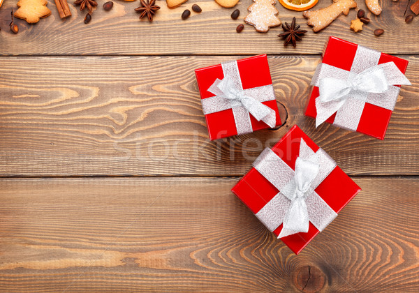 Gift boxes over christmas wooden background with spices and ging Stock photo © karandaev