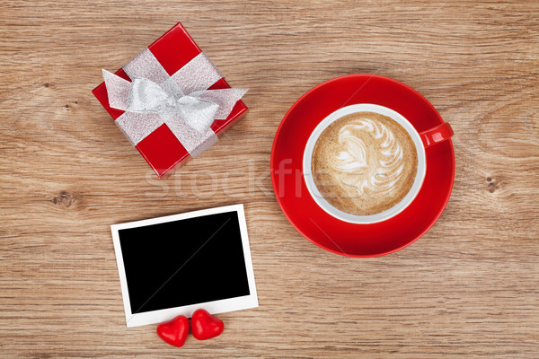 Blank photo frame, gift box and red coffee cup Stock photo © karandaev