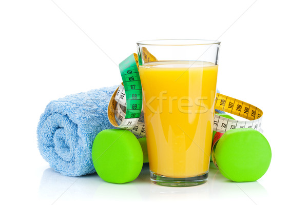 Two green dumbells, tape measure and orange juice. Fitness and h Stock photo © karandaev