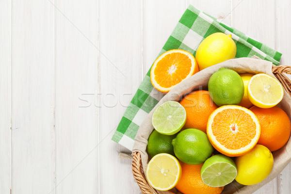 Citrus fruits in basket. Oranges, limes and lemons Stock photo © karandaev