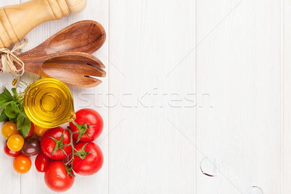 Fresh colorful tomatoes, basil and olive oil Stock photo © karandaev