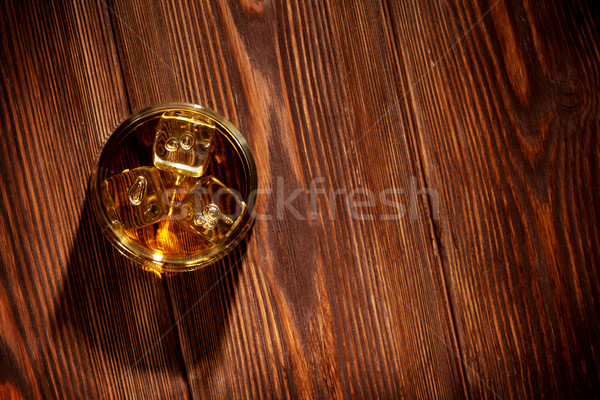 Glass of whiskey with ice Stock photo © karandaev