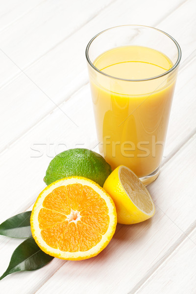 Citrus fruits and glass of juice. Orange, lime and lemon. Stock photo © karandaev