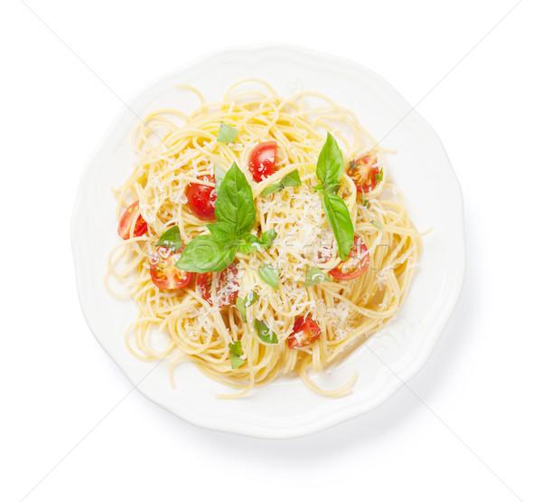 Espaguetis pasta tomates albahaca aislado blanco Foto stock © karandaev