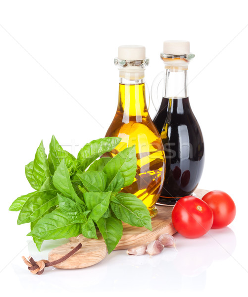 Fresh garden basil, tomatoes and condiments Stock photo © karandaev