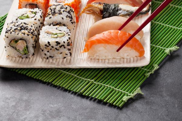 Sushi maki conjunto pedra tabela fundo Foto stock © karandaev