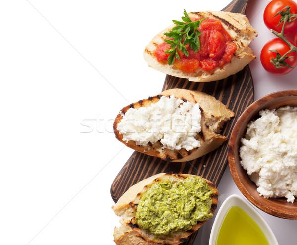 Tost sandviçler domates pesto peynir yalıtılmış Stok fotoğraf © karandaev