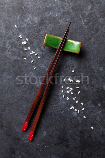 Sushi chopsticks on stone table Stock photo © karandaev