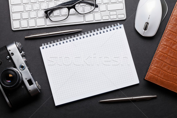 Office desk with camera, pc and notepad Stock photo © karandaev