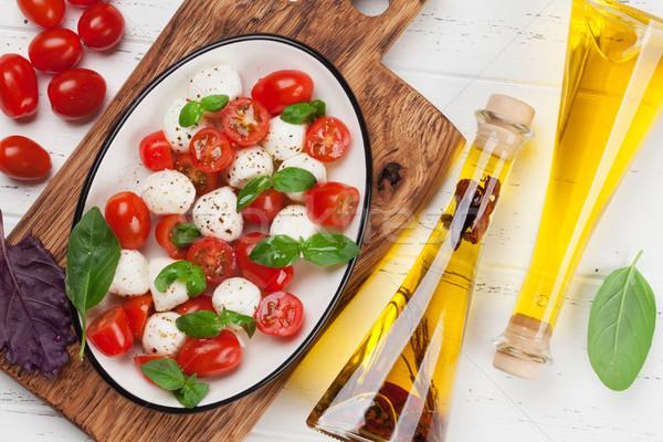 Caprese salatası mozzarella kiraz domates taze bahçe fesleğen Stok fotoğraf © karandaev