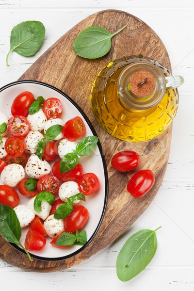 Caprese salatası kiraz domates mozzarella fesleğen üst görmek Stok fotoğraf © karandaev