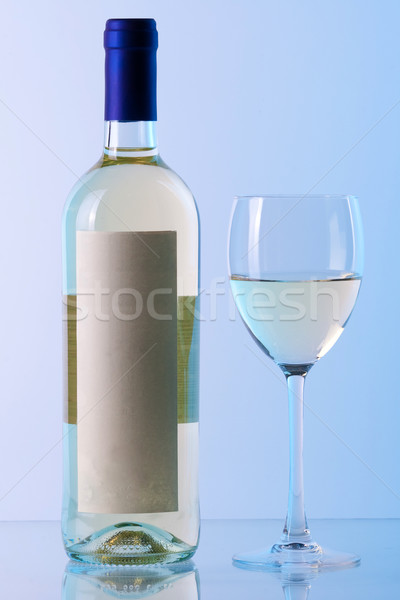 Bottle of white wine and wine glass in blue gamma Stock photo © karandaev