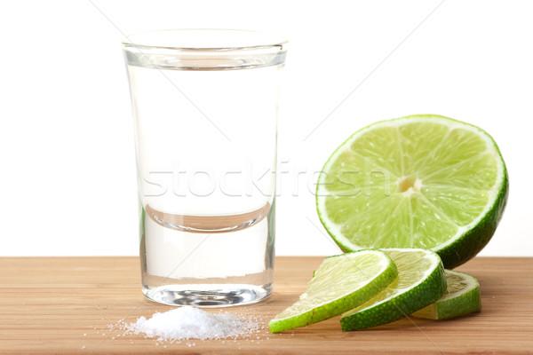 Tequila cal sal mesa de madeira isolado branco Foto stock © karandaev