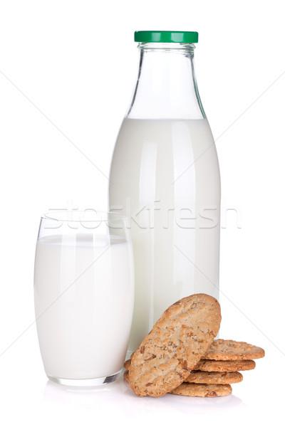 Glass, bottle of milk and cookies Stock photo © karandaev