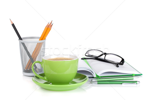Green coffee cup, glasses and office supplies Stock photo © karandaev