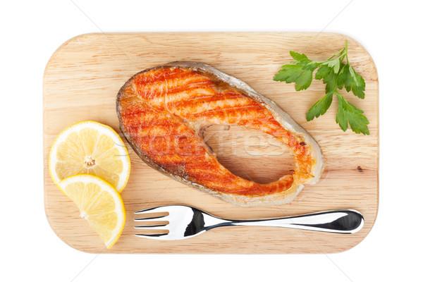 A la parrilla salmón limón rebanadas perejil tabla de cortar Foto stock © karandaev