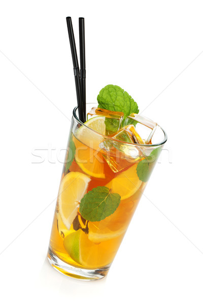 Glass of ice tea with lemon, lime and mint Stock photo © karandaev