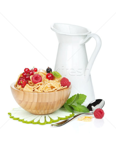 Fresh corn flakes with berries and milk jug Stock photo © karandaev