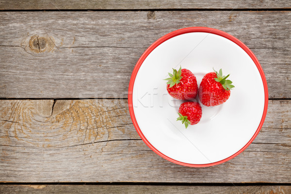Plate with ripe strawberry Stock photo © karandaev