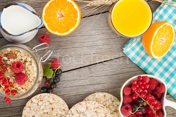 Healty breakfast with muesli, berries and orange juice Stock photo © karandaev