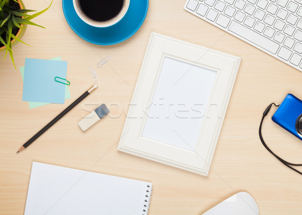 Stock photo: Photo frame on office table with notepad, computer and camera
