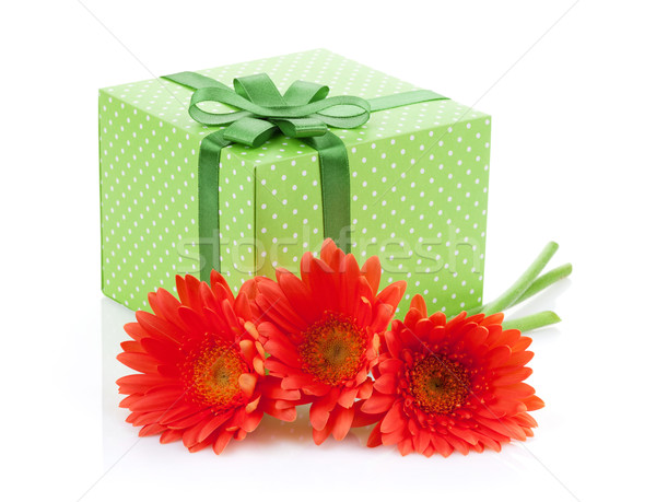 Orange gerbera flowers and gift box Stock photo © karandaev
