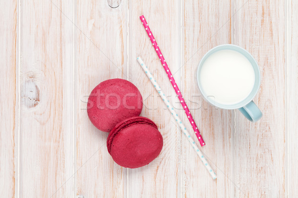 Coloré macarons tasse lait blanche table en bois Photo stock © karandaev