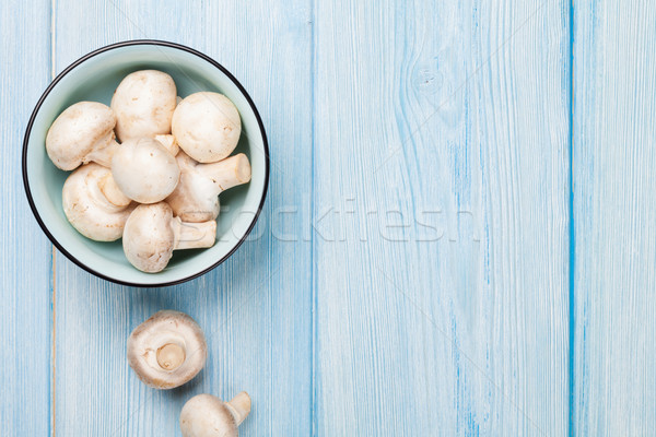Fresh champignon mushrooms Stock photo © karandaev