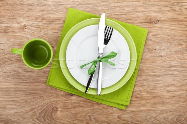 Fork with knife, blank plates and napkin Stock photo © karandaev