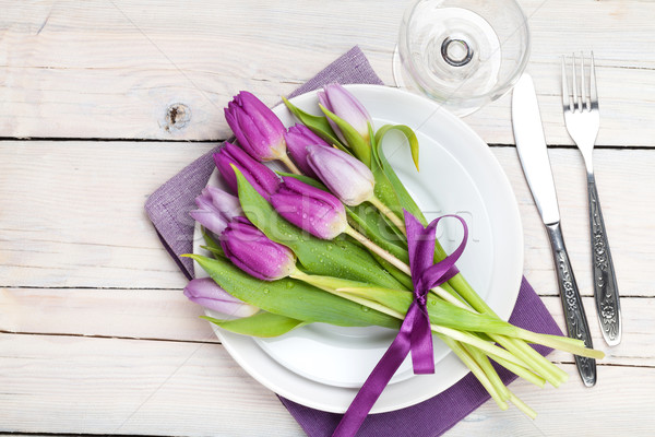 Purple tulip bouquet over plate on wooden table Stock photo © karandaev