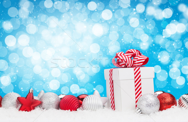 Christmas background with baubles, gift box and bokeh Stock photo © karandaev