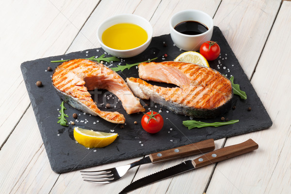 Grilled salmon, salad and condiments Stock photo © karandaev