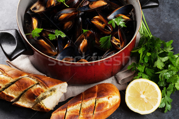 Mussels and bread Stock photo © karandaev