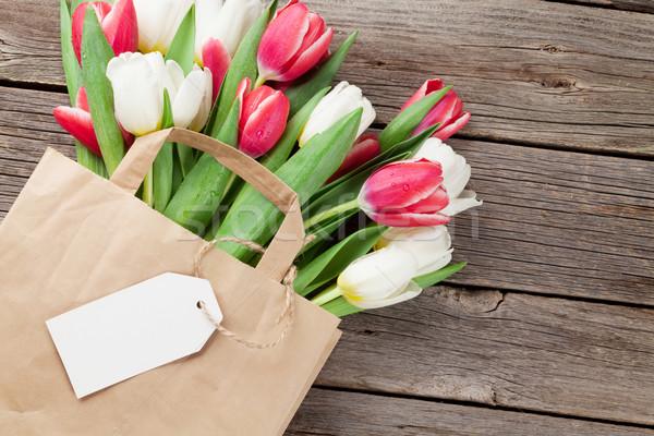 Colorful tulips in paper bag Stock photo © karandaev