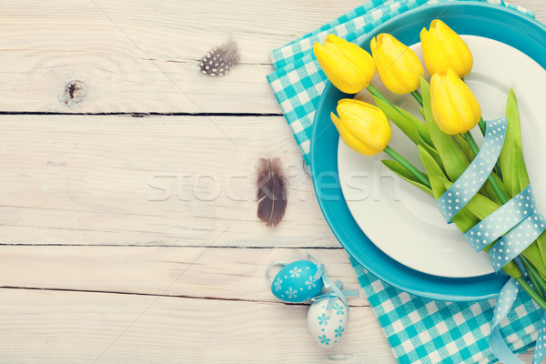 Easter background with yellow tulips and colorful eggs Stock photo © karandaev