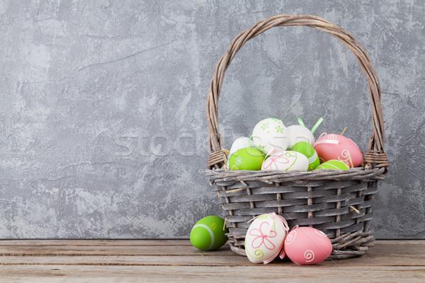 Húsvéti tojások kosár polc kőfal kilátás copy space Stock fotó © karandaev