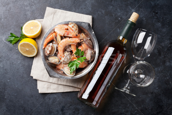 Fresh seafood and white wine Stock photo © karandaev