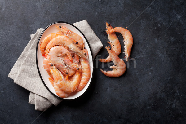 Stock photo: Fresh seafood on stone table. Shrimps