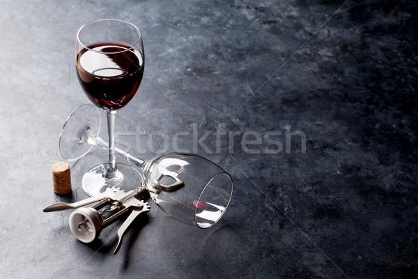 Red wine glasses and corkscrew Stock photo © karandaev