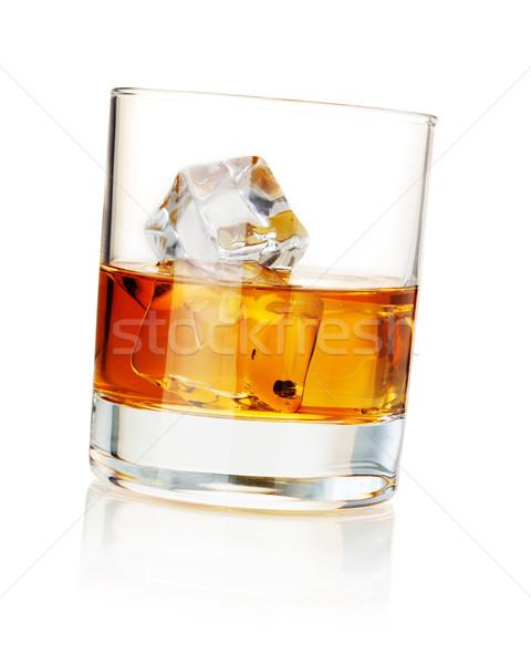 Whiskey with ice cubes Stock photo © karandaev