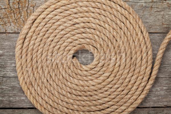 Ship rope on wooden texture background Stock photo © karandaev