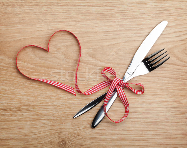 Valentine's Day heart shaped red ribbon and silverware Stock photo © karandaev