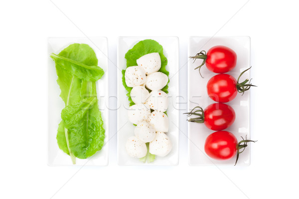 Paradicsomok mozzarella zöld saláta levelek izolált Stock fotó © karandaev