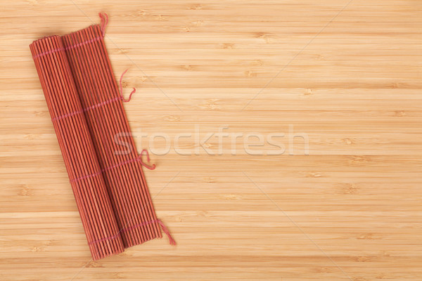 Stock photo: Japanese cooking mat over bamboo table