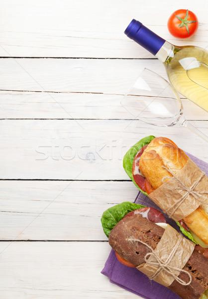 Iki sandviçler beyaz şarap ahşap masa üst görmek Stok fotoğraf © karandaev