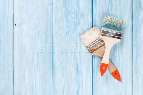 Paintbrush over blue wood Stock photo © karandaev