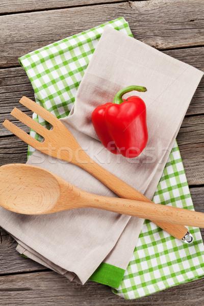 Cooking utensils and bell pepper on wooden table Stock photo © karandaev